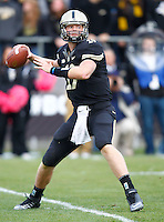 WEST LAFAYETTE, IN - OCTOBER 06: Quarterback Caleb TerBush #19 of the Purdue Boilermakers drops back to pass against the Michigan Wolverines at Ross-Ade Stadium on October 6, 2012 in West Lafayette, Indiana. (Photo by Michael Hickey/Getty Images) *** Local Caption *** Caleb TerBush
