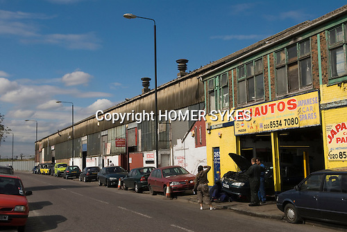 Carpenter Road E15 car repair garages, East London the site of the 2012 Olympic Games village and arena, Stratford, England 2006.