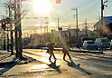 January 24, 2012, Tokorozawa, Japan - Students make their way to school down the frozen streets in Tokorozawa, Tokyos western bedtown suburb, on Tuesday, January 24, 2012. Snow fell in the Metropolitan Tokyo area from Monday night through early Tuesday morning, causing disruption of transportation services and people to slip and suffer injuries. (Photo by Natsuki Sakai/AFLO) AYF -mis-