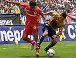 Mexico (27.08.2006) UNAM Pumas defender Efrain Velarde (R) fights for the ball with Toluca Diablos Rojos midfielder  Sergio Ponce during their soccer match at the University Stadium in Mexico City, August, 27, 2006. UNAM Pumas tied 0-0 to Toluca.   © Photo by Javier Rodriguez