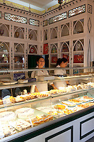 Two female shop keepers in a traditional patisserie in Aracena, Andalucia, Spain