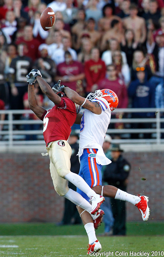 TALLAHASSEE, FL 11/27/10-FSU-UF FB10 CH-Florida State's Greg Reid breaks up a pass intended for Florida's Carl Moore during first half action Saturday at Doak Campbell Stadium in Tallahassee. .COLIN HACKLEY PHOTO