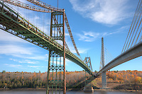 The old and new, the Waldo–Hancock Bridge and the new Penobscot Narrows Bridge, span the Penobscot river connecting Prospect (Waldo County) to Verona Island (Hancock County), Maine.  The Penobscot Narrows bridge was opened in 2006 replacing the Hancock Bridge which was built in 1931 and ultimately demolished in 2013.