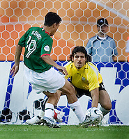 Omar Bravo of Mexico scores a goal against Iranian keeper Ebrahim Mirzapour. Mexico defeated Iran 3-1 during a World Cup Group D match at Franken-Stadion, Nuremberg, Germany on Sunday June 11, 2006.