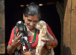 Bishnu Kumari Banjara holds two of her goats in Dhawa, a village in the Gorkha District of Nepal. Following the 2015 earthquake that ravaged Nepal, she received several baby goats from Dan Church Aid, a member of the ACT Alliance, as a way to earn a livelihood and restart the village economy. Helping people in this and other largely Dalit villages has been a priority for ACT Alliance agencies.