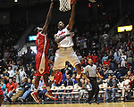 "Ole Miss' Murphy Holloway (31) vs. Rutgers' Dane Miller (2) at the C.M. ""Tad"" Smith Coliseum in Oxford, Miss. on Saturday, December 1, 2012. (AP Photo/Oxford Eagle, Bruce Newman).."