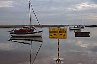 Burnham Overy Staithe, Norfolk, England, 06/08/2009..Early morning boating in Burnham Overy Staithe harbour.