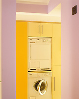 The use of bright colour cheers up the utillity area in this space saving kitchen.
