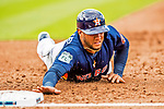 1 March 2017: Houston Astros infielder Yuli Gurriel dives safely back to first during Spring Training action against the Miami Marlins at the Ballpark of the Palm Beaches in West Palm Beach, Florida. The Marlins defeated the Astros 9-5 in Grapefruit League play. Mandatory Credit: Ed Wolfstein Photo *** RAW (NEF) Image File Available ***