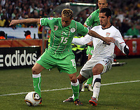 Benny Feilhaber (right) of USA and Karim Ziani (left) of Algeria. USA defeated Algeria 1-0 in stoppage time in the 2010 FIFA World Cup at Loftus Versfeld Stadium in Pretoria, Sourth Africa, on June 23th, 2010.