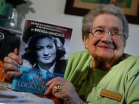 NWA Media/DAVID GOTTSCHALK - 10/6/14 - Nicole Holland, a Springdale resident, displays the book her daughter, Brenda Hancock, has written about her and the experiences she had as a French Jew in the French Underground during WWII Monday October 6, 2014.
