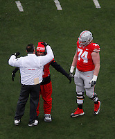 OhioState BuckeyeUrban Meyer hugs Ohio State Buckeyes safety Christian Bryant (2) and Ohio State Buckeyes offensive linesman Jack Mewhort (74)at senior day against Indiana Hoosiers at Ohio State Stadium in Columbus  Nov. 23, 2013.