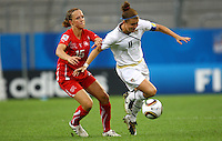 USA's Christine Nairn (R) and Lia Waelti of Switzerland during the FIFA U20 Women's World Cup at the Rudolf Harbig Stadium in Dresden, Germany on July 17th, 2010.