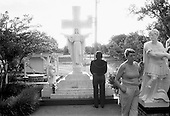 Memphis, Tennessee<br /> USA<br /> August 12, 2002<br /> <br /> At sunrise an Elvis impersonator prays at the grave of Elvis Presley honoring the 25th anniversary of the King's death.