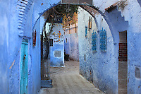 Narrow street painted blue with overhead archways in the medina or old town of Chefchaouen in the Rif mountains of North West Morocco. Chefchaouen was founded in 1471 by Moulay Ali Ben Moussa Ben Rashid El Alami to house the muslims expelled from Andalusia. It is famous for its blue painted houses, originated by the Jewish community, and is listed by UNESCO under the Intangible Cultural Heritage of Humanity. Picture by Manuel Cohen