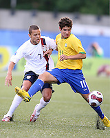 Alexandre Pato keeps Danny Szetela at bay. USA stunned Brazil, winning 2-1 to finish first in their group. Final game in group D in Ottawa, Ontario, on JULY 6 2007.