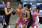 19 February 2015: North Carolina's N'Dea Bryant (22) tries to knock the ball away from Wake Forest's Dearica Hamby (25) as Wake Forest's Ataijah Taylor (3) and North Carolina's Latifah Coleman (2) watch. The University of North Carolina Tar Heels hosted the Wake Forest University Demon Deacons at Carmichael Arena in Chapel Hill, North Carolina in a 2014-15 NCAA Division I Women's Basketball game.