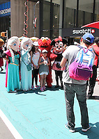 NEW YORK, NY - JUNE 21: Costumed characters pose for photos with tourists in the green zone on the first day of NYPD (New York Police Department) enforcement of the new pedestrian zones in Times Square where costumed characters and those selling bus or show tickets are required to solicit only in the designated green zone in New York, New York on June 21, 2016.  Photo Credit: Rainmaker Photo/MediaPunch