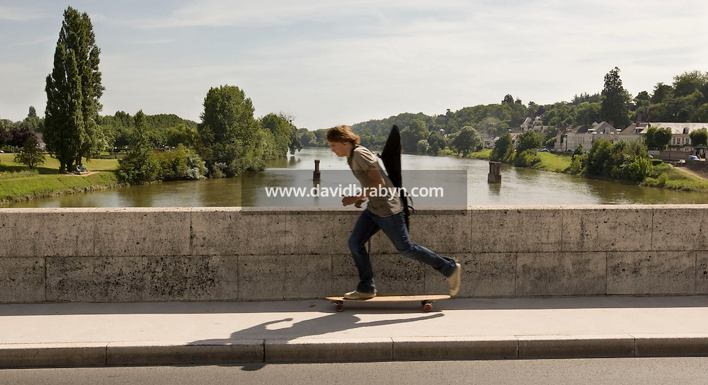 A young man skateboards across the Loire Valley in Amboise, France, 26 June 2008.