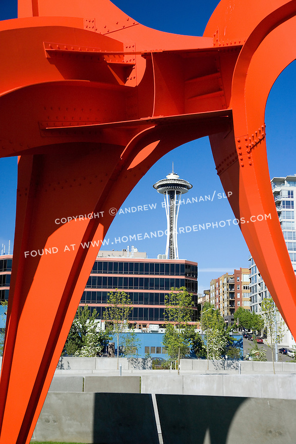 """Seen up close, the vivid red of Alexander Calder's, """"Eagle, 1971"""" contrasts with the vivid blue of a Northwest sky and the white spire of the Space Needle several blocks away.   SAM's Olympic Sculpture Park, Seattle, WA."""