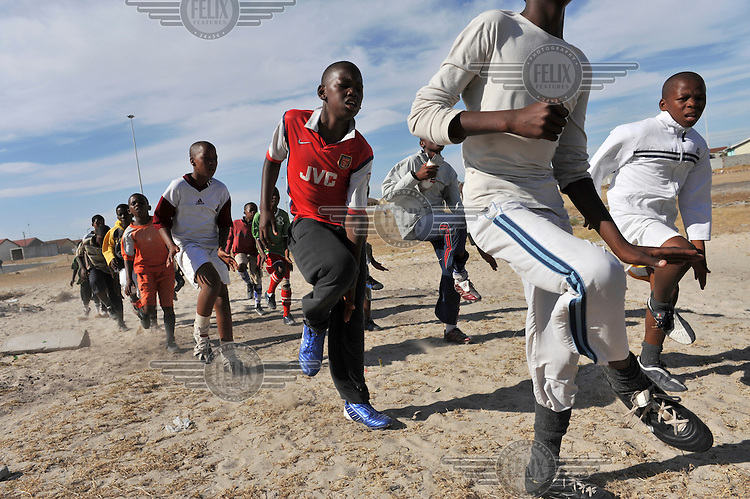 Local boys and girls during a football practice in the Khayelitsha Township.