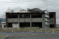 A landscape view of a damaged building following the 311 Tohoku Tsunami in Onagawa, Japan  © LAN