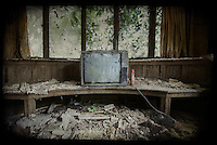 Old television in an abandoned house