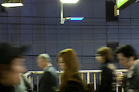 Japanese people walk past blue lights installed at all 29 JR Yamanote Line stations for a cost of 15 million Yen (165,000 USD) in an effort to decrease suicides by people jumping under trains. Over 2,000 people jumped under trains in 2008, accounting for 6% of all suicides in the country. The blue LED lights are meant to calm and soothe potential jumpers, though there is little scientific evidence for this. Japan has one of the highest suicide rates in the world which the recent economic crisis has exacerbated. Shibuya Station, Tokyo, Japan December 4th 2009