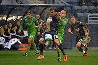 Carlos Ruiz (20) of the Philadelphia Union and Osvaldo Alonso (6) of the Seattle Sounders FC battle for the ball. The Philadelphia Union and the Seattle Sounders FC played to a 1-1 tie during a Major League Soccer (MLS) match at PPL Park in Chester, PA, on April 16, 2011.