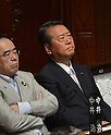 June 26, 2012, Tokyo, Japan - Grim-faced Ichiro Ozawa, right, a stalwart member of the ruling Democratic Party of Japan,  awaits the start of a plenary session of the Diet lower house in Tokyo on Tuesday, June 26, 2012..The House of Representatives passed the sales tax hike legislation with the backing of two main opposition parties by 363 to 96 votes. Ozawa and his followers voted against the legislation, causing a severe division within the ruling party. (Photo by Natsuki Sakai/AFLO)