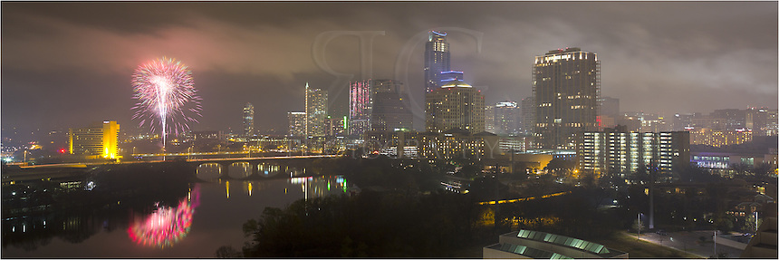 The fog was low and it rained all day in Austin on December 31, 2012. I didn't have much hope when I left my house to photograph the fireworks. I knew the roof I was shooting from was 24 stories high and I was afraid I'd be immersed in a cloud. When I arrived, however, the fog lifted for about an hour or so. ..This image is of downtown Austin for the New Year's celebration 2013. The Austonian is the tallest buliding with the blue lights on top. To its left is the 360 Condos (with the spier on the top left. Across the river under the fireworks is the Hyatt. The bridges are Congress and 1st Street. The fireworks were shot across Ladybird Lake from Auditorium Shores...Shortly after I returned to my car, the rains came again. It was a good night!
