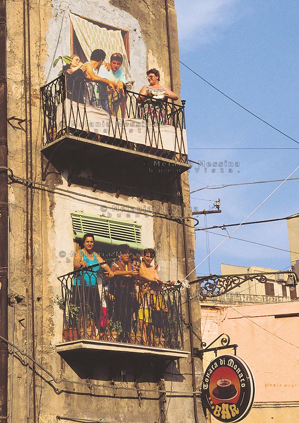 Historic city center Palermo, balconies in Ballaro' market neighborood.<br /> Centro storico di Palermo, quartiere del mercato Ballaro'