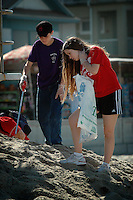Saturday, September 20 2008.  Pacific Beach, San Diego, CA, USA:  Brother and sister Jeff and Mary Benton search for trash on Pacific Beach with members of Scout Troop 295 from Clairmont.  Volunteers in the annual Coastal Cleanup found little to clean up beyond cigarette butts on San Diego's Alcohol free beaches.