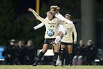 21 November 2014: Colorado's Carly Bolyard (12) and North Carolina's Annie Kingman (behind). The University of North Carolina Tar Heels hosted the University of Colorado Buffaloes at Fetzer Field in Chapel Hill, NC in a 2014 NCAA Division I Women's Soccer Tournament Second Round match. UNC won the game 1-0 in overtime.
