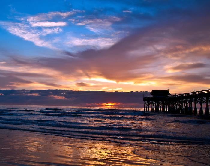 Colorful sunrise at the Cocoa Beach Pier in March, Cocoa Beach, Florida