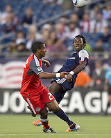 New England Revolution forward Kenny Mansally (7) heads the ball. In a Major League Soccer (MLS) match, the New England Revolution tied Toronto FC, 0-0, at Gillette Stadium on June 15, 2011.