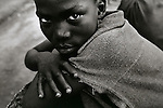 Face of a 14 year old war veteran..Freetown, Sierra Leone, May 1997..?When evil doing comes like falling rain, nobody calls out. ?stop!?. When.crimes begin to pile up they become invisible..When sufferings become unendurable the cries, too, fall like rain in.summer,? .? Berthold Brecht.