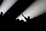 Concert-goers are seen silhouetted against the spotlight as rapper Lil Wayne performs at the Beacon Theatre July 22, 2007 in New York. Robert Caplin For The New York Times