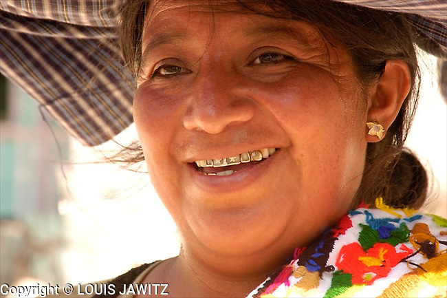 Woman in traditional dress, Belize sales lady, .jpg