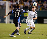 LA Galaxy defender Todd Dunivant (2) beats San Jose Earthquake midfielder Bobby Convey (11) to the ball. The LA Galaxy and the San Jose Earthquakes played to a 2-2 draw at Home Depot Center stadium in Carson, California on Thursday July 22, 2010.