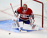 24 September 2009: Montreal Canadiens' goaltender Jaroslav Halak makes a first period save against the Boston Bruins at the Bell Centre in Montreal, Quebec, Canada. The Bruins edged out the Canadiens 2-1 after an overtime shootout in a pre-season matchup. Mandatory Credit: Ed Wolfstein Photo