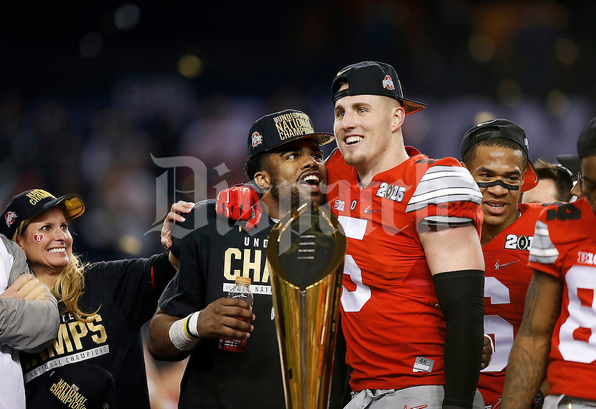 Ohio State Buckeyes running back Ezekiel Elliott (15) and Ohio State Buckeyes tight end Jeff Heuerman (5) celebrate following the College Football Playoff National Championship at AT&T Stadium in Arlington, TX on Monday, January 12, 2015. (Columbus Dispatch photo by Jonathan Quilter)