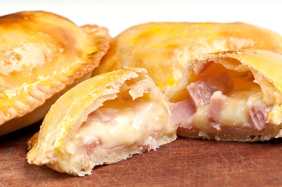 Ham and Cheese Empanada fill close up.  The Empanada is a pastry turnover filled with a variety of savory ingredients and baked or fried.