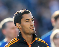 Houston Dynamo midfielder Tony Cascio (28). In a Major League Soccer (MLS) match, the New England Revolution (blue/white) defeated Houston Dynamo (orange), 2-0, at Gillette Stadium on April 12, 2014.