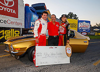 Sep 2, 2016; Clermont, IN, USA; Papa Johns pizza founder John Schnatter (left),  NHRA team owner Don Schumacher (center) and top fuel driver Leah Pritchett pose for a photo following a charity match race prior to qualifying for the US Nationals at Lucas Oil Raceway. Mandatory Credit: Mark J. Rebilas-USA TODAY Sports