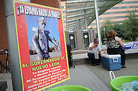 "Phoenix, Arizona - A sign with a photo of Mexican street performer Melchor Flores Hernández, known as ""El Vaquero Galáctico"" --or The Galactic Cowboy-- is seen on display at the Civic Space Park in Downtown Phoenix. Flores Hernández went missing in Monterrey, Nuevo Leon, Mexico in February 2009. According to reports, Flores Hernandez was arrested several times for performing on the street without a permit. He disappeared after being arrested by police. The sign demands to the governor of Nuevo Leon to solve the case. The ""Caravan for Peace with Justice and Dignity"" stopped in Phoenix on Wednesday, August 15, 2012 as it travels across the United States as a way to create awareness in the United States about the failed drug war in Mexico that has left more than 70,000 dead. The caravan is led by Mexican poet, essayist, novelist, and journalist Javier Sicilia, whose son Juan Francisco Sicilia Ortega son was brutally murdered along with six other students in Morelos, Mexico by members of a drug cartel on March 28, 2011. In response, Sicilia created the Movement for Peace with Justice and Dignity --popularly known as ¡Ya Estamos Hasta la Madre! or We Have Had It!-- calling for an end the drug cartels bloodshed. Photo by Eduardo Barraza © 2012"