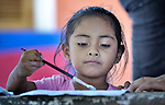 Evelyn Garcia Aguilar paints a picture during a session of the early intervention program of Piña Palmera, a center for community based rehabilitation for people living with disabilities in Zipolite, a town in Oaxaca, Mexico. The 4-year old girl is deaf.
