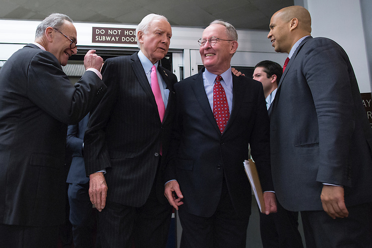 UNITED STATES - NOVEMBER 18 - Sen. Chuck Schumer, D-N.Y., greets Sen. Orrin Hatch, R-Utah, as Hatch and Sen. Lamar Alexander, R-Tenn., arrive at the U.S. Capitol and walk past Sen. Cory Booker, D-N.J., in Washington, Wednesday, November 18, 2015. (Photo By Al Drago/CQ Roll Call)