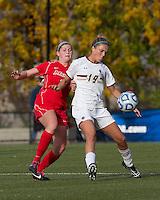 Boston College midfielder Kristen Mewis (19) controls the ball as Marist College midfielder/defender Jamie Strumwasser (3) pressures.  Boston College defeated Marist College, 6-1, in NCAA tournament play at Newton Campus Field, November 13, 2011.