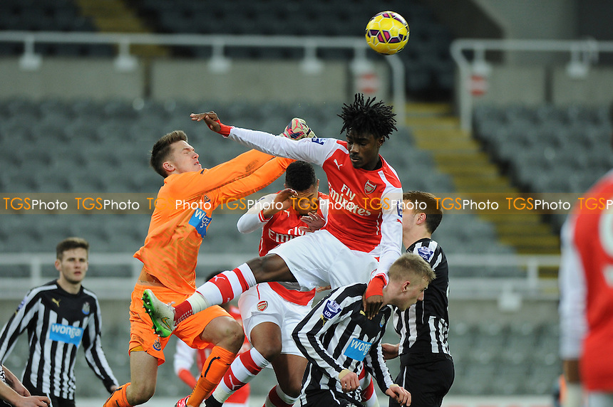 Freddie Woodman punches clear a corner from Stefan O'Connor of Arsenal - Newcastle United Under-21 vs Arsenal Under-21 - Barclays Under-21 Premier League Football at St James Park, Newcastle United FC - 09/02/15 - MANDATORY CREDIT: Steven White/TGSPHOTO - Self billing applies where appropriate - contact@tgsphoto.co.uk - NO UNPAID USE